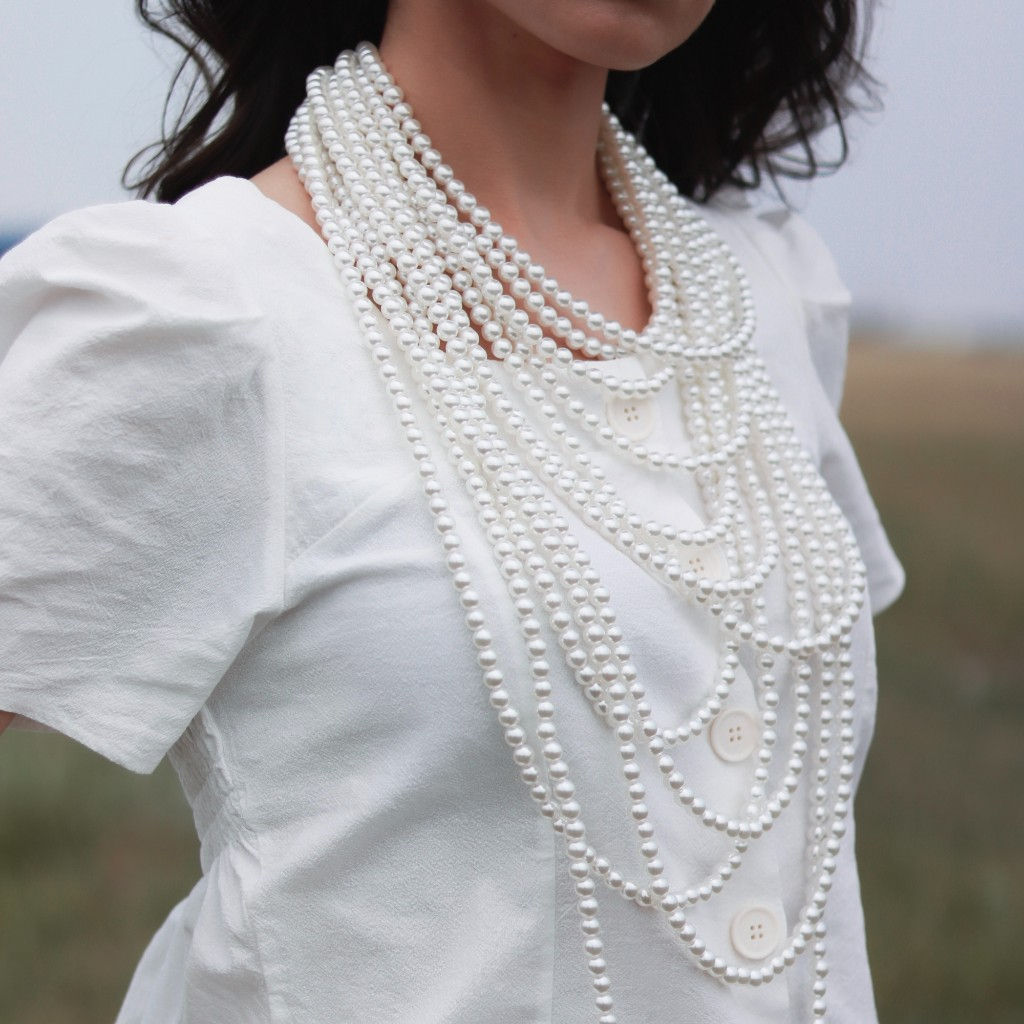 why being authentic is better woman with a lot of pearls