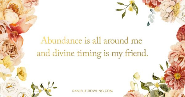 """quote image that says """"abundance is all around me and divine timing is my friend."""""""