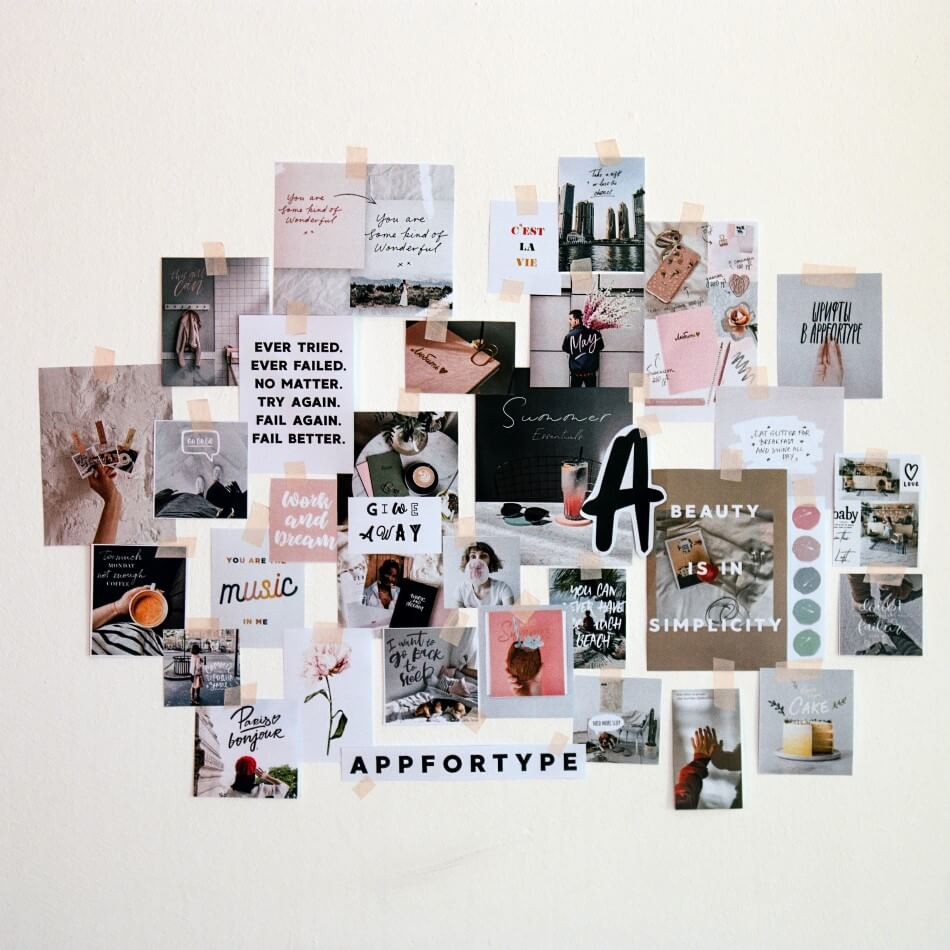 collage of photos on a wall Photo by Andy Art on Unsplash