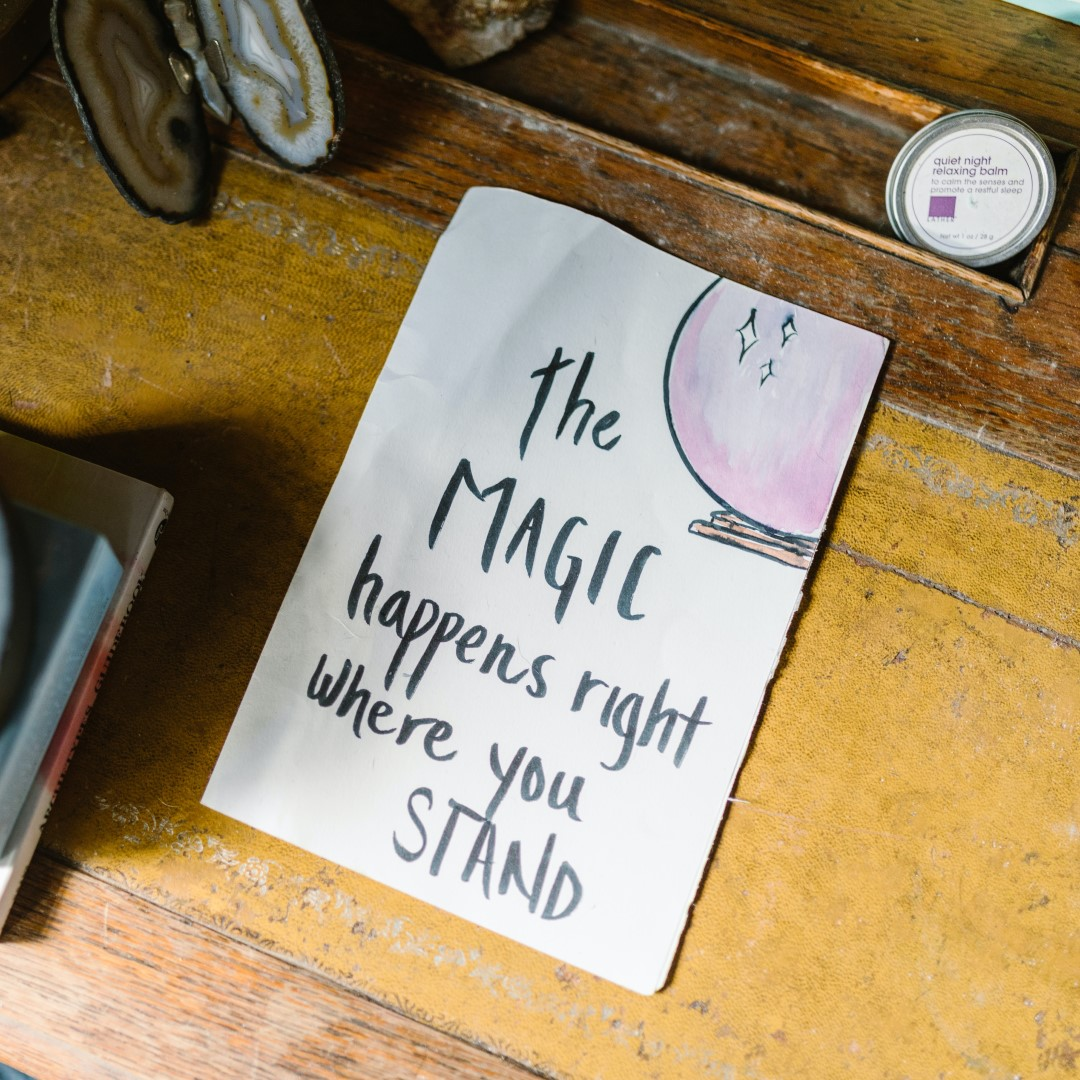 """hand writing on paper saying """"the magic happens right where you stand"""""""